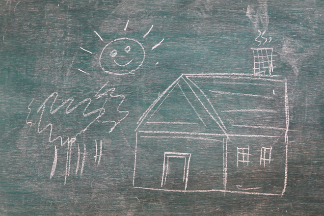 image of drawn house on a blackboard