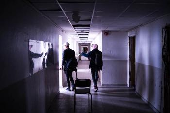 photo of two young men walking down a hallway